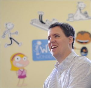 "In this March 1, 2011 photograph, Jeff Kinney, author of the children's book series, ""Diary of a Wimpy Kid,"" responds to a reporter's question at his office in Boston. (AP Photo/Gretchen Ertl)"