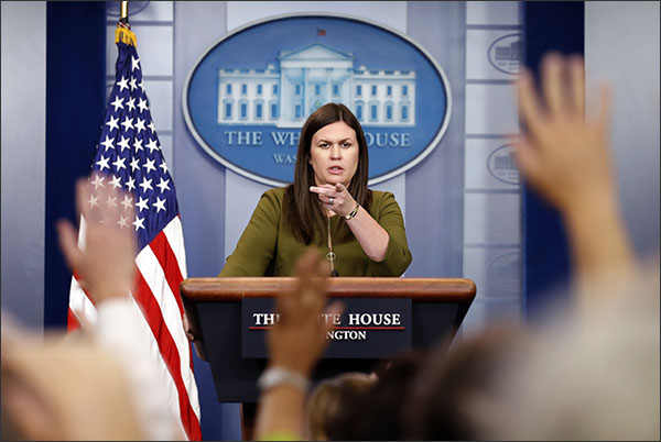Deputy White House press secretary Sarah Huckabee Sanders points to a questioner during an off-camera