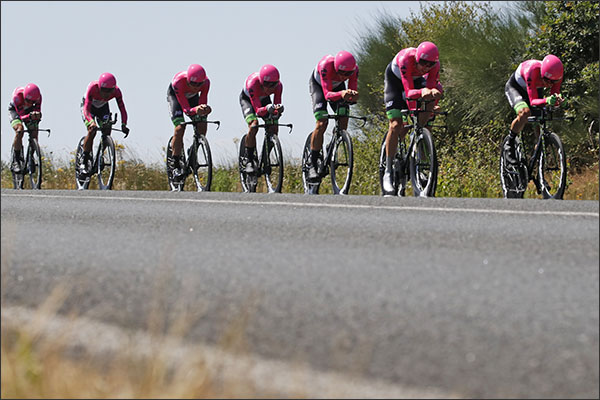 Team EF Education First - Drapac P/B Cannondale strains during the third stage of the Tour de France cycling race, a team time trial over 22 miles, with start and finish in Cholet, France, Monday, July 9, 2018. (AP Photo/Christophe Ena)