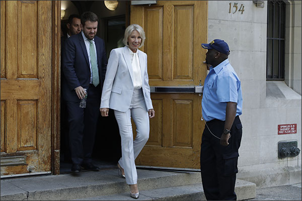 U.S. Education Secretary Betsy DeVos steps out of the Manhattan High School for Girls, Tuesday, May 15, 2018, in New York. DeVos met with students and faculty for several hours at the orthodox Jewish private school. (AP Photo/Mark Lennihan)
