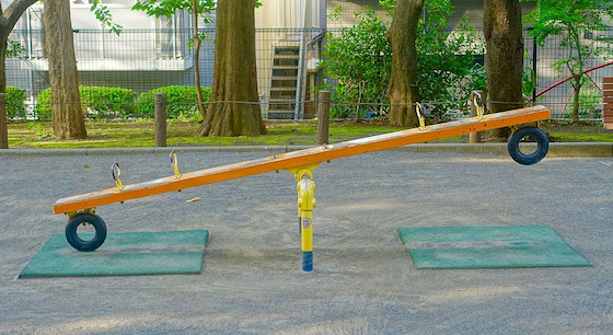 A seesaw on a playground.