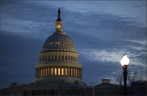 The lamp remains illuminated in the top of the Capitol Dome in Washington before dawn Tuesday, Feb. 7, 2017, indicating that the Senate was still at work as Democrats remained on the floor overnight to oppose the confirmation of Education Secretary-designate Betsy DeVos. The Senate is poised to confirm President Donald Trump's controversial nominee by the narrowest possible margin, with Vice President Mike Pence expected to break a 50-50 tie. (AP Photo/J. Scott Applewhite)