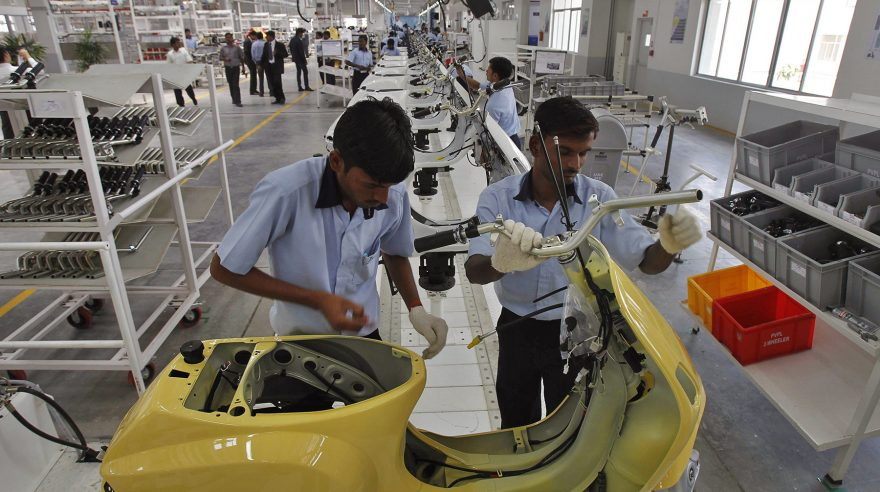 Indian laborers work at the manufacturing unit of Vespa scooters plant in Baramati some 150 kilometers (93 miles) from Pune, India, Saturday, April 28, 2012. Piaggio Vehicles Limited India inaugurated its plant today. The Italian company has spent $30 million on its new factory in Baramati, in the state of Maharashtra, and plans to spend $20 million more to double capacity to 300,000 scooters a year by 2013. (AP photo/Rafiq Maqbool)