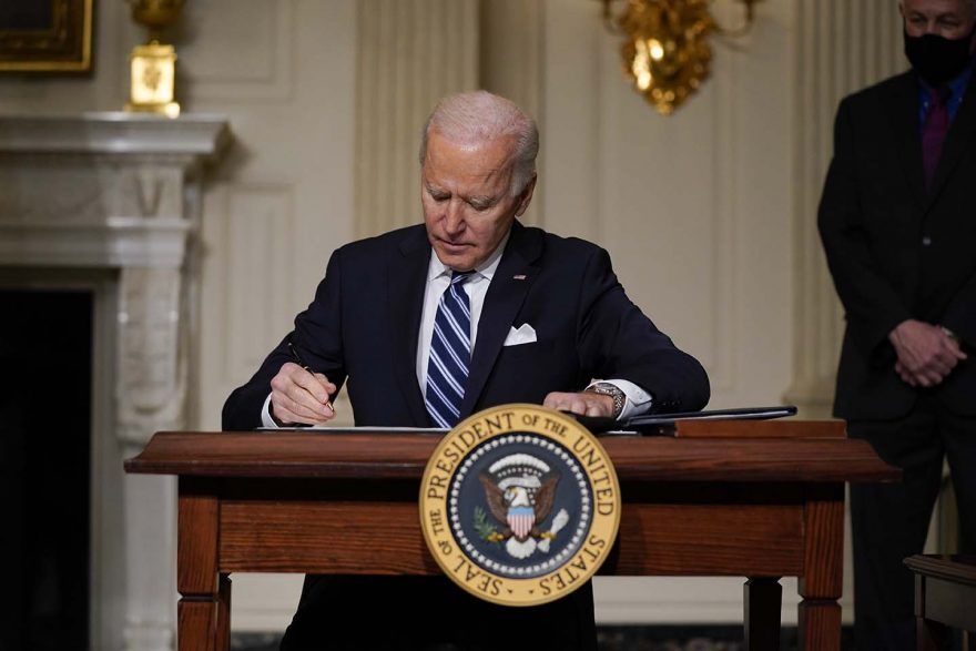 Joe Biden signing executive orders